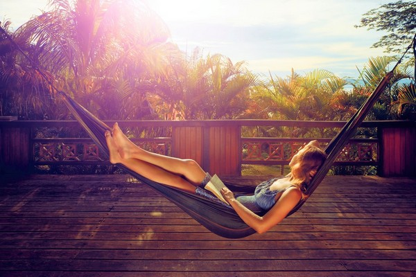 all inclusive versus self catered  woman reading alone on holiday