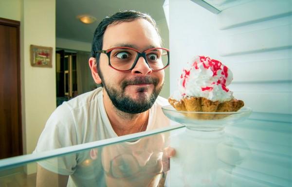 man leering at pie
