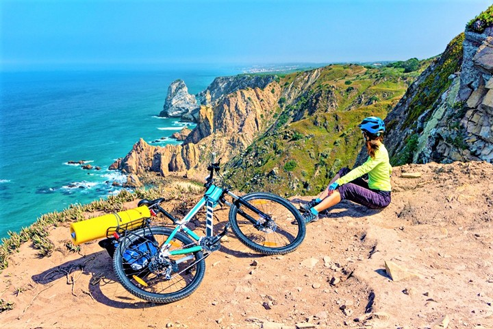 Portugal scenery with biking woman