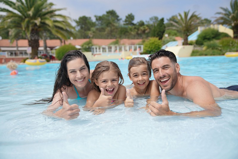 family in a pool at a water park