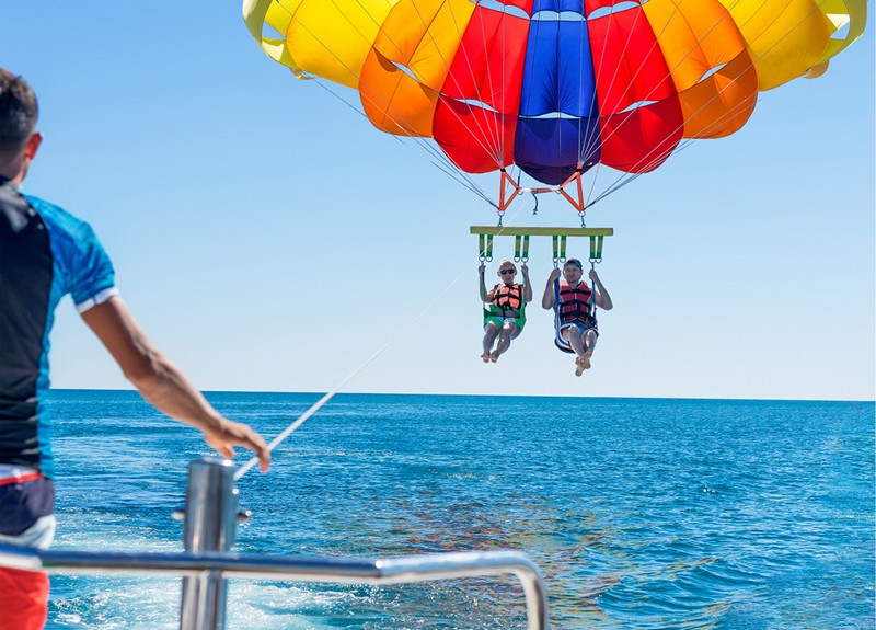 People enjoying parasailing
