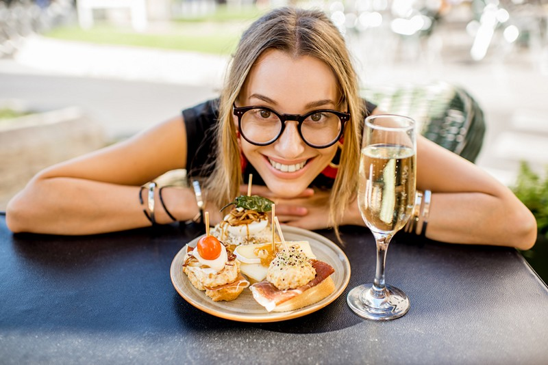 young woman eating tapas