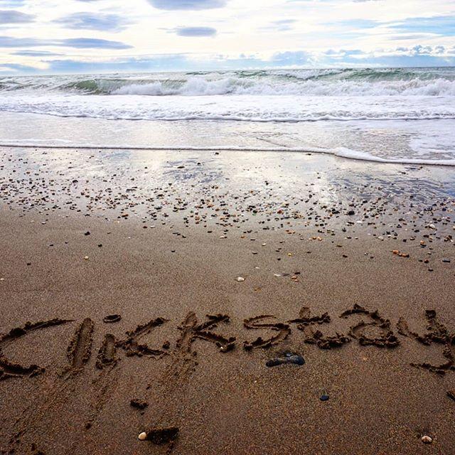 Clickstay written on beach