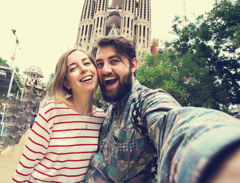 couple taking selfie with Sagrada Familia Barcelona Spain