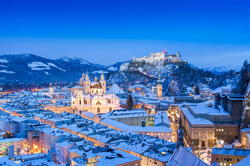 Beautiful view of the historic city of Salzburg with Festung Hohensalzburg in winter, Salzburger, Austria