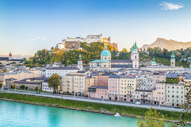 Beautiful view of the historic city of Salzburg with Hohensalzburg Fortress in beautiful golden evening light at sunset, Salzburger Land, Austria