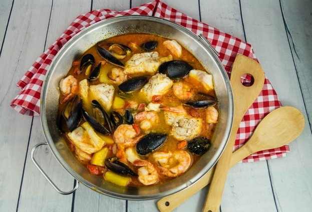 Seafood cataplana served in traditional cataplana cookware