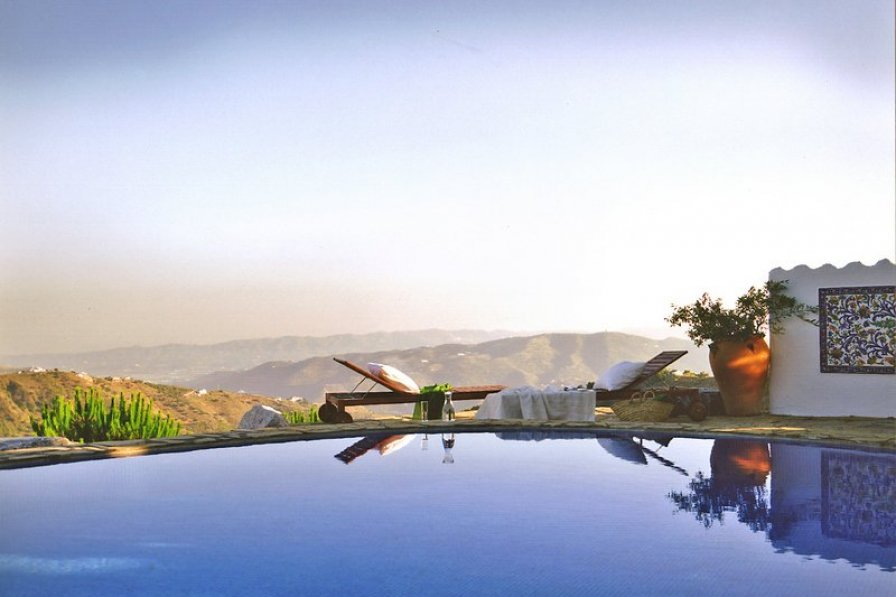 Infinity pool at Cortijo Maria Camila, a spacious Spanish farmstead