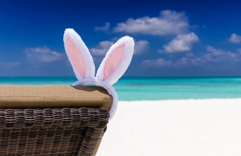 Easter bunny ears on a sunbed by the beach