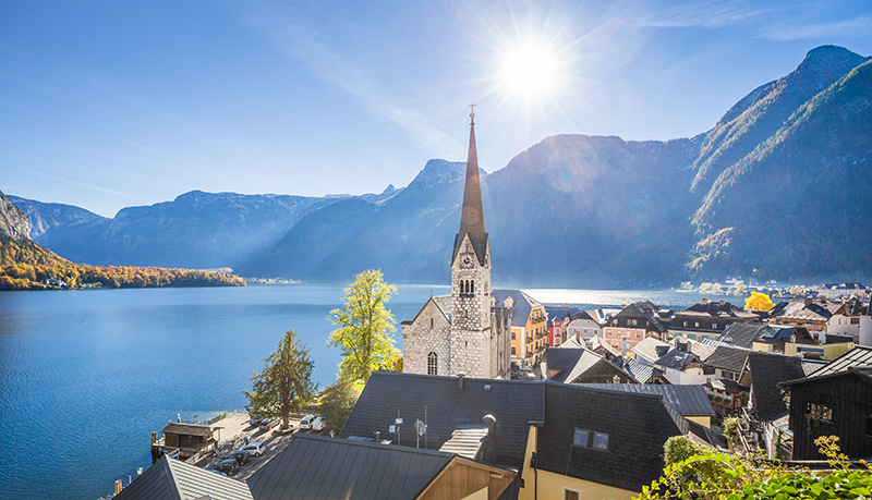 Historic town of Hallstatt with colorful houses and church at Hallstatter Austrian Alps, region of Salzkammergut, Austria
