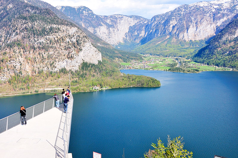 Tourists walking to the spectacular viewing platform World Heritage View on the Salzberg, 350 meters above the rooftops of Hallstatt