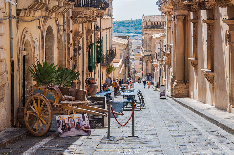 Traditional Sicilian cart on street in old city centre of Noto