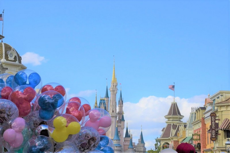 Disney castle obscured slightly by baloons