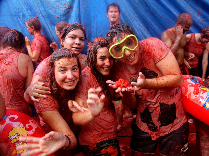 Group of friends taking part in La Tomatina