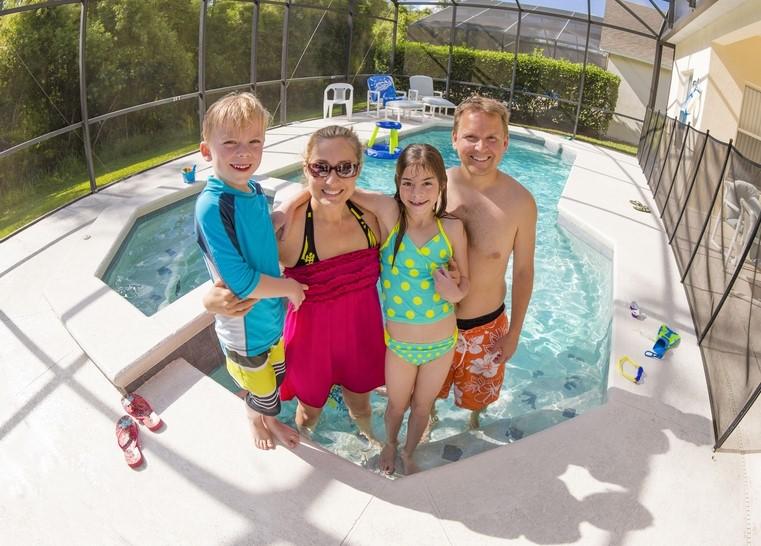 Family outside a backyard pool in Florida