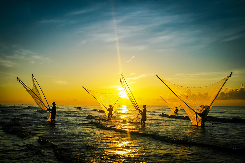 Fishermen working in the village of Hai Hau Vietnam