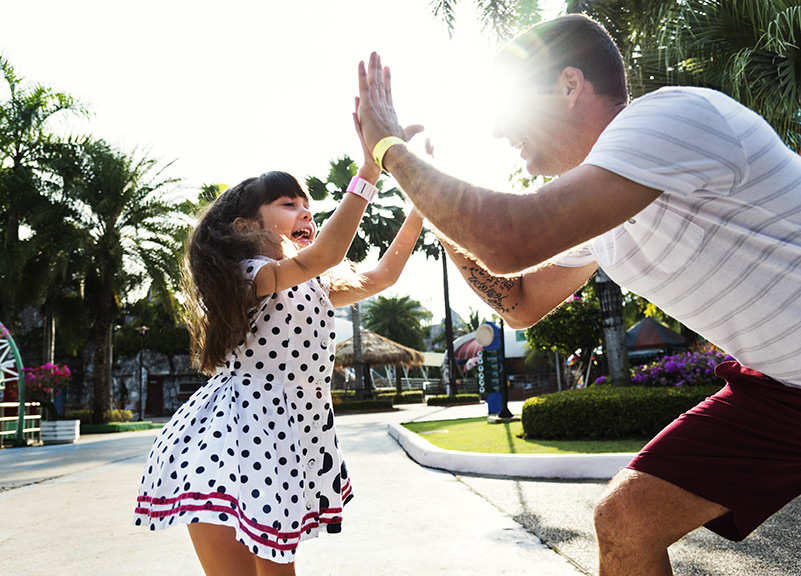 Child and Father in double high five