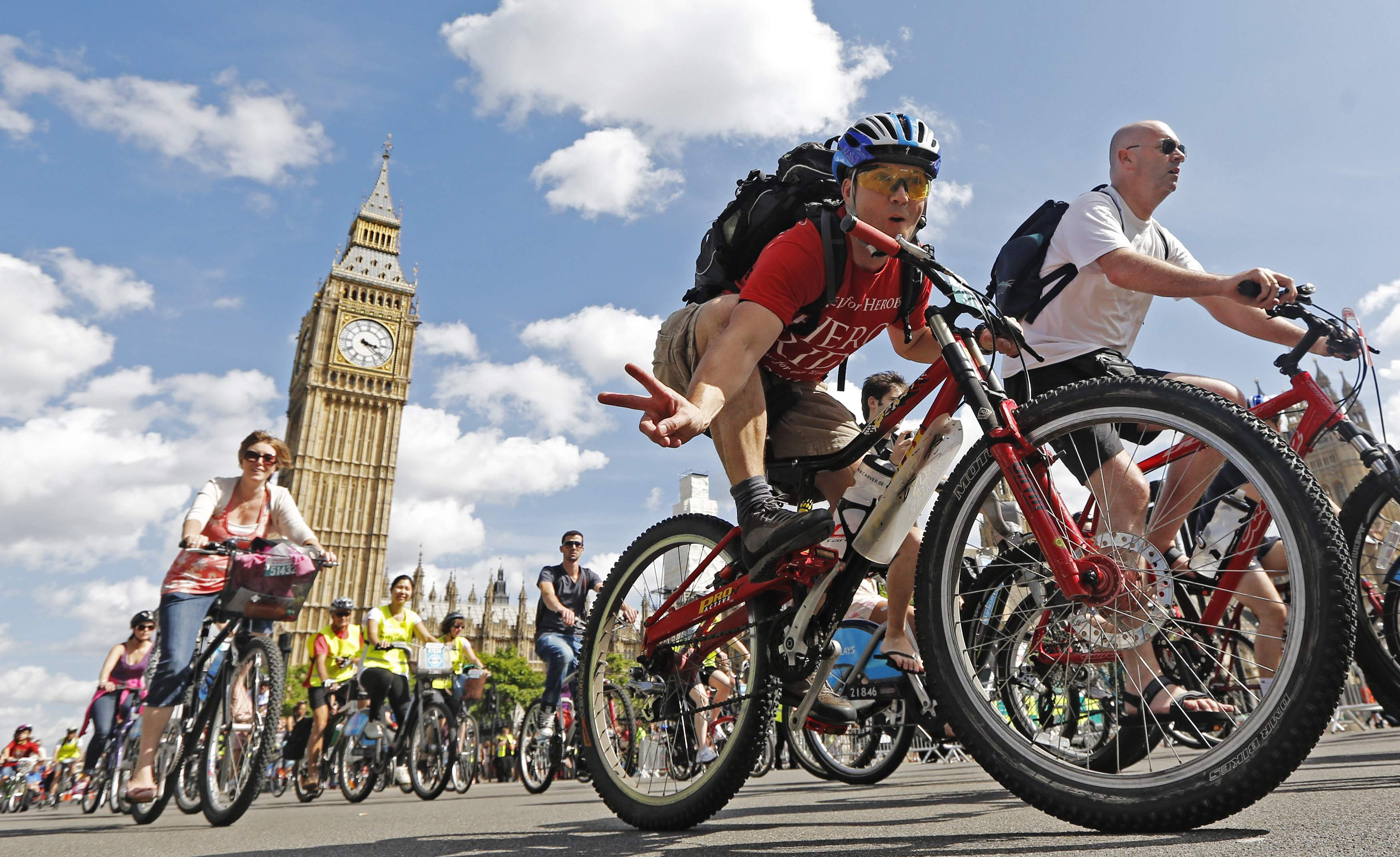 Cyclists of all ages ride past the Houses of Parliament during the Prudential RideLondon FreeCycle ride in central London