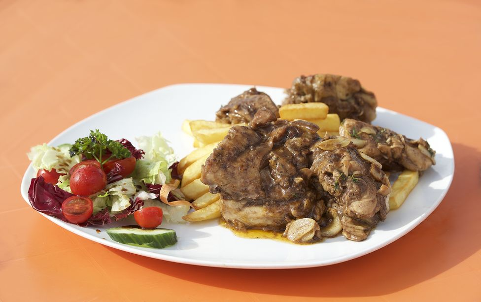 A traditional dish in Malta,rabbit served with fresh vegetables
