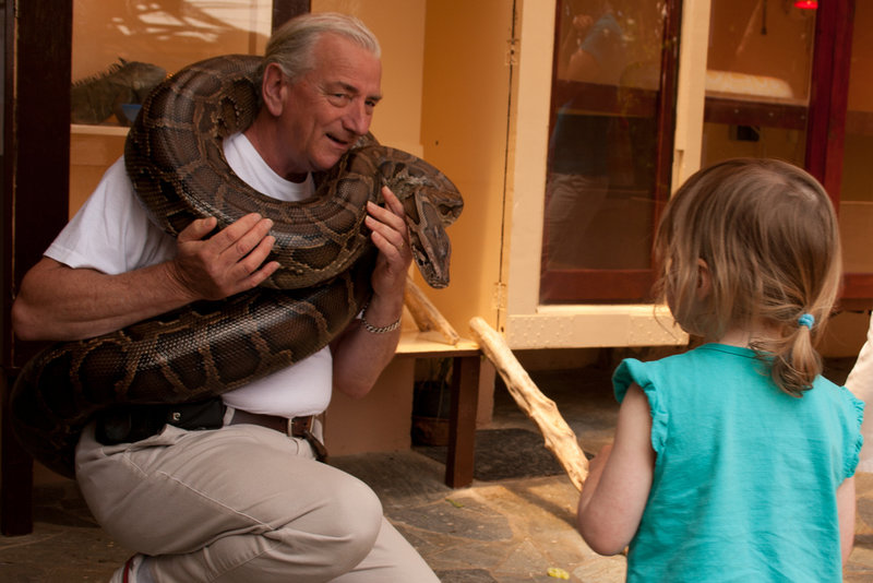 Man holding snake at Reptile Rescue Centre in Crete