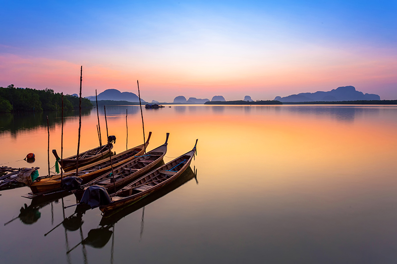 Wooden boats at sunset in Thailand