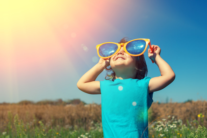 little girl with sunglasses enjoying the sunshine