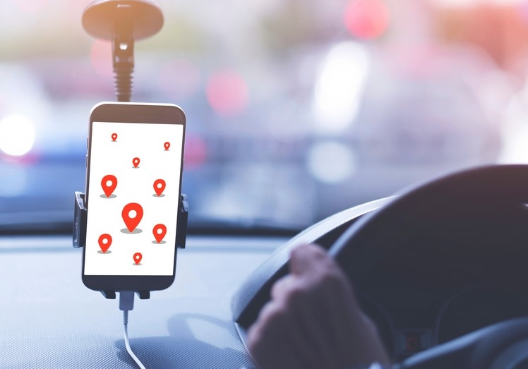taxi hailing app in a car