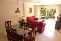 Apartment in Spain, Carib Playa: Spacious lounge dining area leads onto the garden terrace