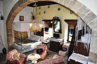 Village_house in Greece, Koskinou: MAIN LIVING ROOM WITH SATELITE TV AND DOUBLE BED AND SOFA BED