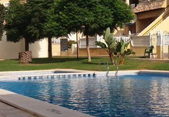 Apartment in Spain, Las Filipinas: Large pool and garden area.