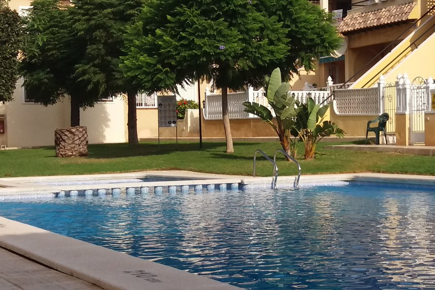 Owners abroad Ground floor apartment with front and rear gated terrace.