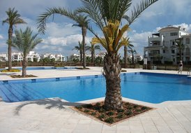 Apartment in La Torre Golf Resort, Spain: Two swimming pools directly outside apartment