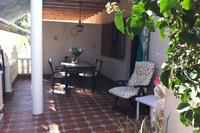 Villa in Spain, Playa Flamenca: View across the terrace towards the front door.