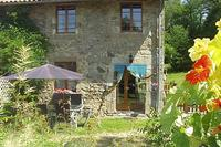 Gite in France, Nontron: Patio at rear with gas barbecue