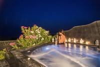 Villa in Greece, Oia: Outdoor private heated hydromassage spa.