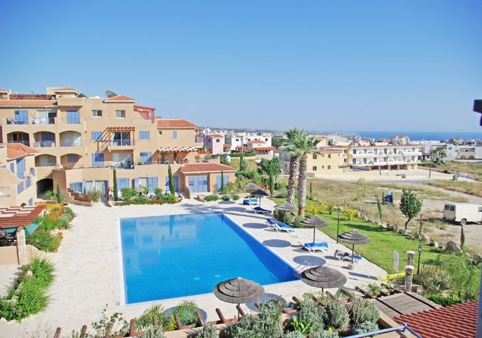 Apartment in Cyprus, Peyia: Large swimming pool with stunning views of Coral Bay and the Mediterra..