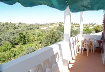 Apartment in Portugal, Corgos: The private terrace has beautiful views of the surrounding area, an..