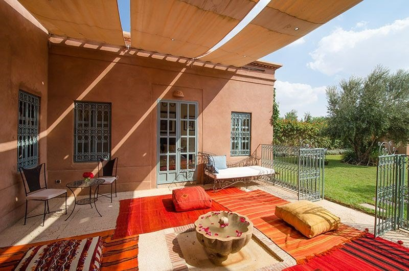 Villa in Morocco, Touihina: Patio area outside living room set up with day beds, sofas and rugs