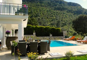 Villa in Turkey, Ovacik: Dining table, bar and pool area