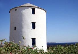 Ancient renovated windmill by the sea in Stavros (Tinos)