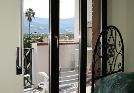Apartment in Pompei, Italy: Bedroom with one king size double bed and one single bed, access to te..