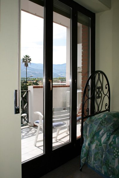 Apartment in Italy, Pompei: Bedroom with one king size double bed and one single bed, access to te..