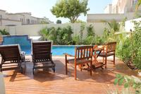Villa in United Arab Emirates, Dubai: Decked area with Sun Beds & Garden Furniture