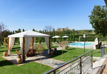 Villa in Italy, Castiglion Fiorentino: View from terraces overlooking gardens, pool and historic t..