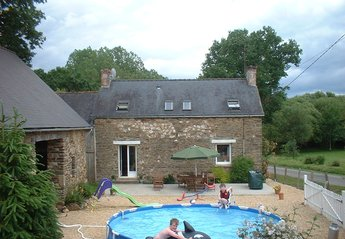 Farm_house in France, Josselin: Relax on the spacious patio with BBQ and pool