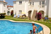 Apartment in Spain, Oliva Nova: Communal pool and garden. Table, chairs and sunloungers outside ou..