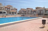 Apartment in Spain, Aguas Nuevas: Pool and child's pool with tiled surround and lawned garden