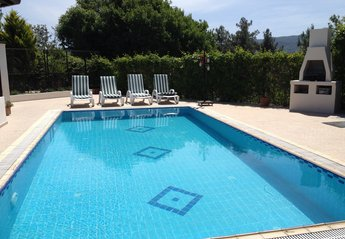 Villa in Turkey, Atakoy: A beautiful pool and patio area complete with loungers and bbq areas a