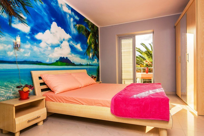 Exclusive 2 bedrooms apartments yard away from a sandy beach