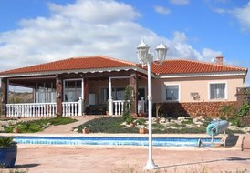 Detached  villa 2 ensuite bedrooms, private solar heated pool.